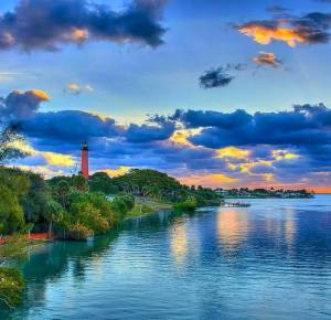 blue yellow cloudy sky lighthouse and water