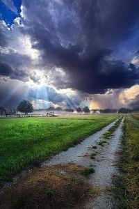 horizon sun rays clouds pathway
